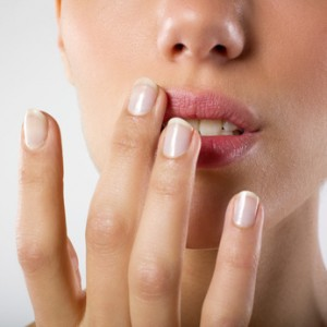 woman touching her lips with fingertips